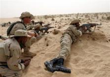 soldiers in sand_Reuters